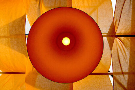 imaginary line: Modern yellow lamp on a background of yellow cloth