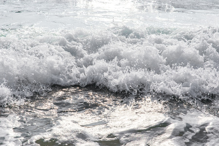seawater: seawater with sea foam and waves