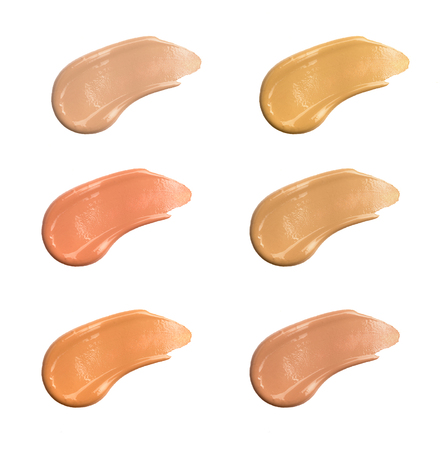 Shades Of Foundation On White Background. Closeup Of Different Tones Of Liquid Foundation, Makeup Product Texture. High Quality