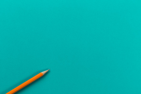 wooden pencil on menthol background, top view