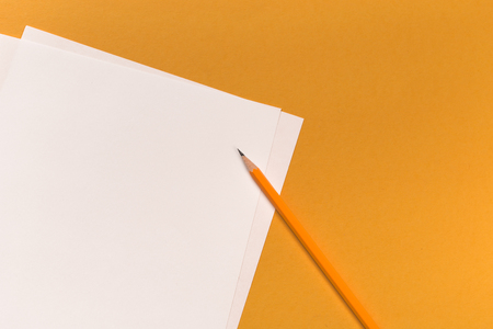 Pencils with sharpening shavings with white paper sheets on coloured backgroung, Office tool 写真素材