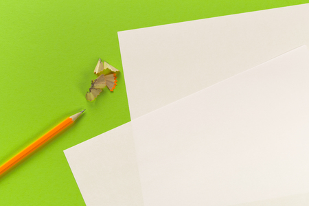 Pencils with sharpening shavings with white paper sheets on colored background, Office tool 写真素材