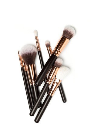 Set of brushes for powder. Powder brush set. Cosmetic brush. Cosmetic product. Powder brush over white background. Cosmetic set. Make up brushes. Make up set. Isolated brushes on white background