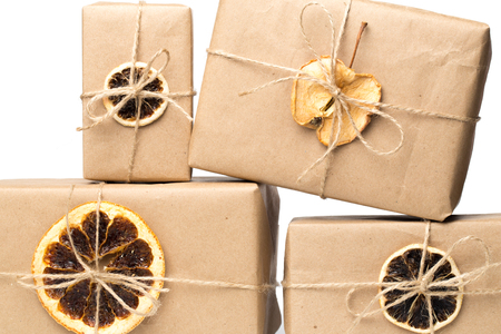 craft paper presents with dry citrus isolated on white 스톡 콘텐츠