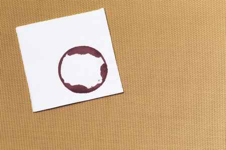 White napkin with wine trace on textured background Фото со стока