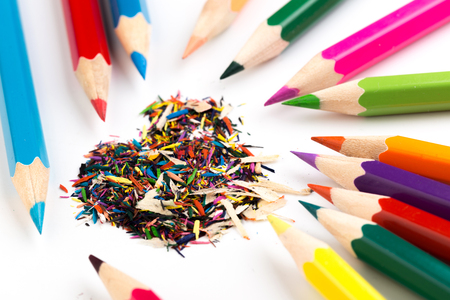 colour pencils with shavings isolated on white