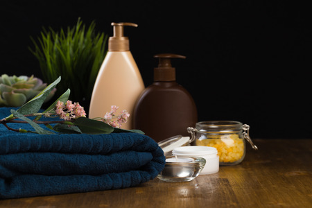 Spa still life with aromatic candles, flower and towel. - Image Stock Photo