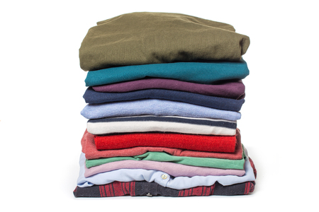 Stacks of folded clothes on white background