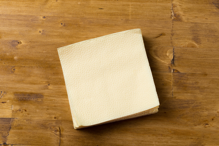 paper napkin on wooden background