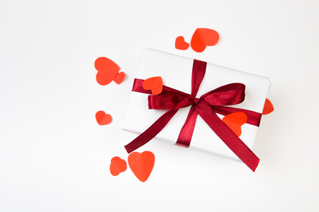 Valentine day composition: gift boxe with bow and red hearts, photo template, background. Top View Stock Photo