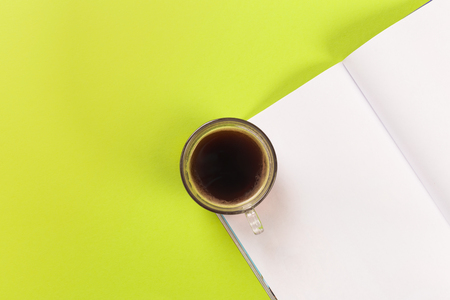 magazine mock up with coffee on green background