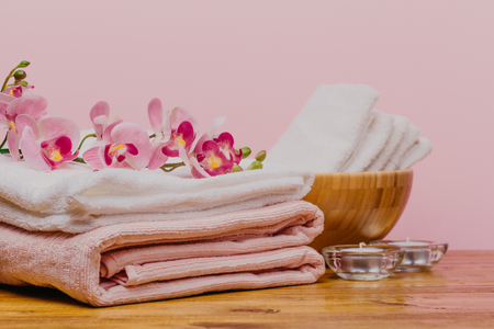 Spa still life with aromatic candles,orchid flower and towel. - Image