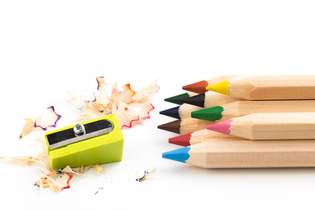 Wooden colorful pencils isolated on a white background, pencil sharpeners 免版税图像