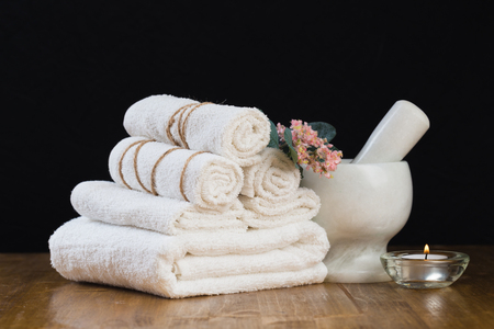 Spa still life with aromatic candles and towel. - Image