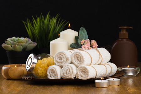 Spa still life with aromatic candles, flower and towel. - Image Фото со стока