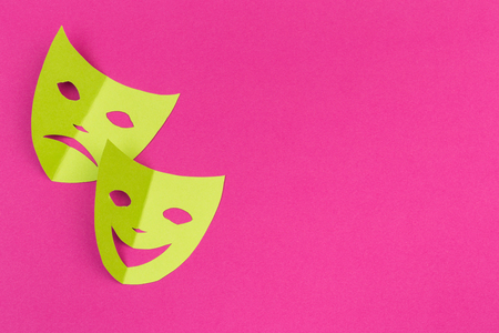 cut out colored paper figures for the holiday Mardi Gras, colour background