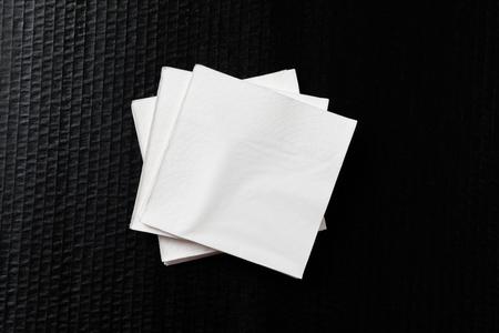 Paper napkin on black background Stock Photo - 122560647
