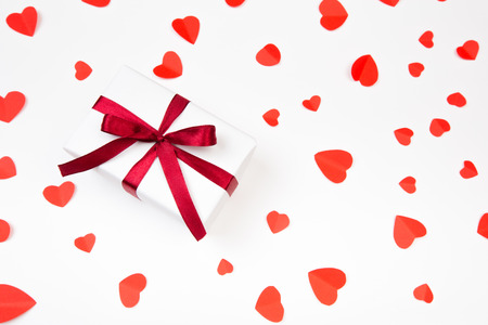Valentine day composition:  gift boxe with bow and red  hearts, photo template, background. Top View