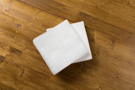 white paper napkin on wooden background Stock Photo - 122560814