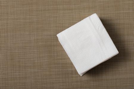 Paper napkin on textured background