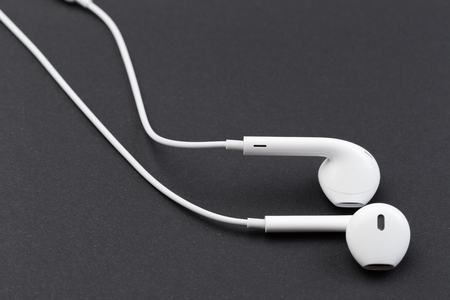 white earphones on black background Stock Photo