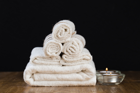 Spa still life with aromatic candles and towel. - Image Standard-Bild - 122561405
