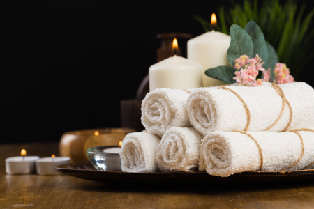 Spa still life with aromatic candles, flower and towel. - Image 写真素材