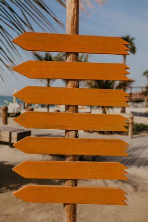 set of orange wooden arrow pointers- Image