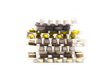 Some tablets blister packs with various pills and capsules stacked and on white background - Image Reklamní fotografie