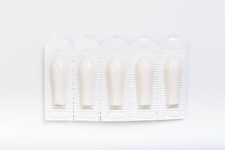 plastic packs of suppositories on white  background - Image