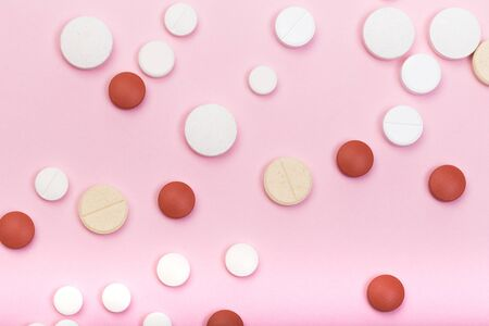 red and white pills on pink background- Image Stock fotó