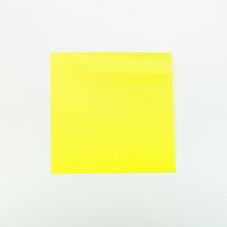 Yellow paper stick note on a white background - Image Stockfoto
