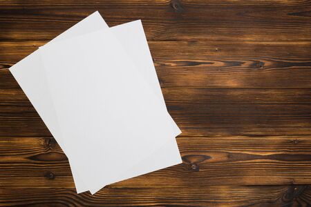 Blank paper sheets on  wooden background - Image