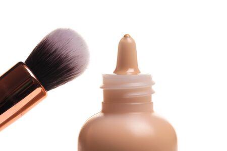 Liquid makeup foundation cream and brush isolated on white background - Image