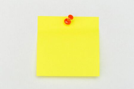 Note with a paper clip. Isolated on a white background - Image