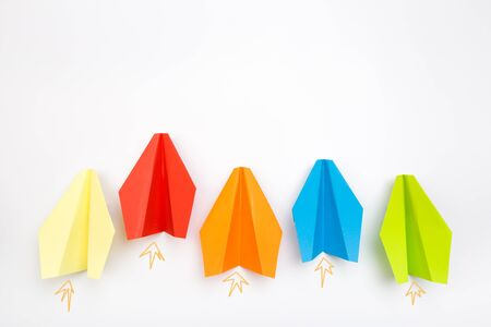 Colorful paper plane on white background, Business competition concept - Image