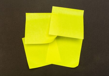 set of colour paper stick note on a black background - Image