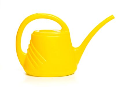 yellow watering can isolated on white background - Image