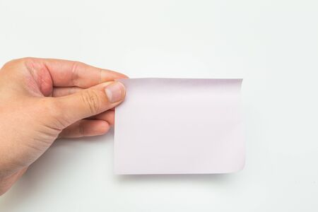sticky note with hand on white background - Image