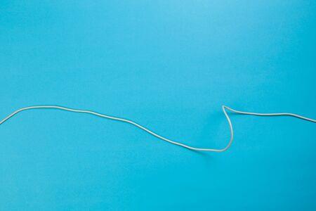 white power cable socket on blue background - Image
