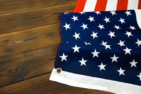 American flag on a old wooden desk top view - Image