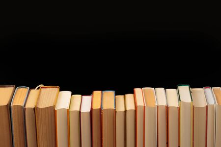 Stack of books on a black  background.Education. - Image 스톡 콘텐츠