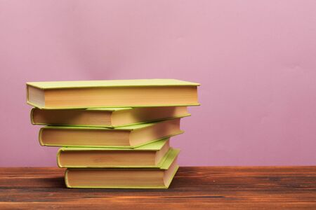 pile of old books, panorma, good copy space on pink background - Image Reklamní fotografie
