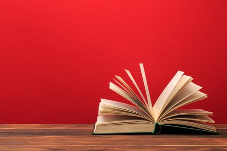Open book on red background. text place - Image Stock Photo