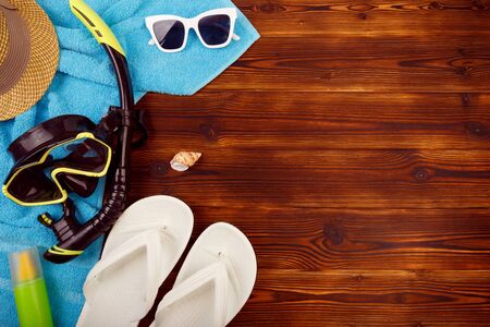 Vacation travel equipment Straw hat, sunglasses And marine objects, shells, on wooden floor