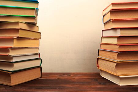 Old books on a wooden shelf. -  Image