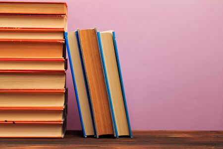 pile of old books, panorma, good copy space  on pink background - Image