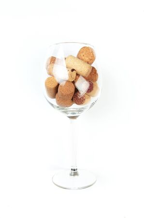 Wine corks in glass isolated on white background. Focus on wine corks
