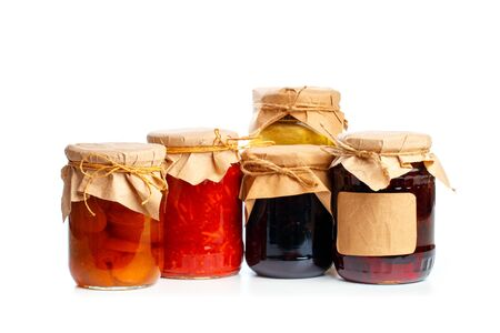 set og  glass bottles with preserved food on white background - Image