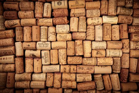 Closeup pattern background of many different wine corks with dates and drops of wine